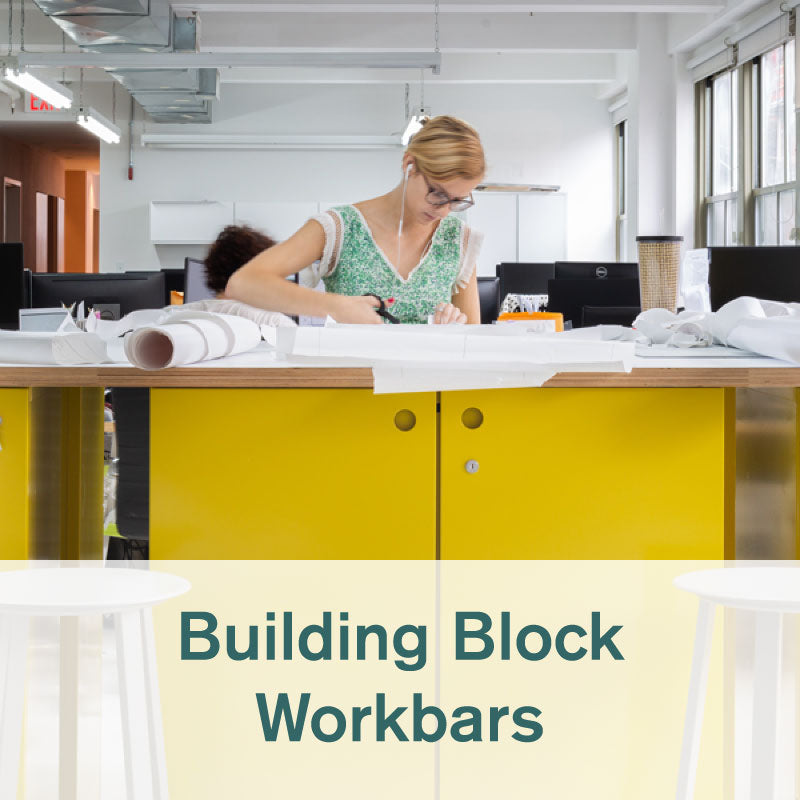 Heartwork Building Block workbar in yellow in office setting with girl cutting paper on the top surface