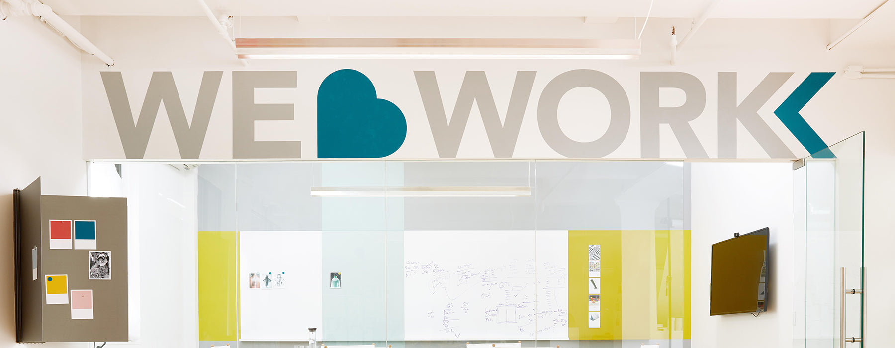 "Heartwork showroom interior showing ""We Love Work"" quote"