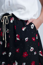 Load image into Gallery viewer, Black Mini Skirt With Floral Pattern