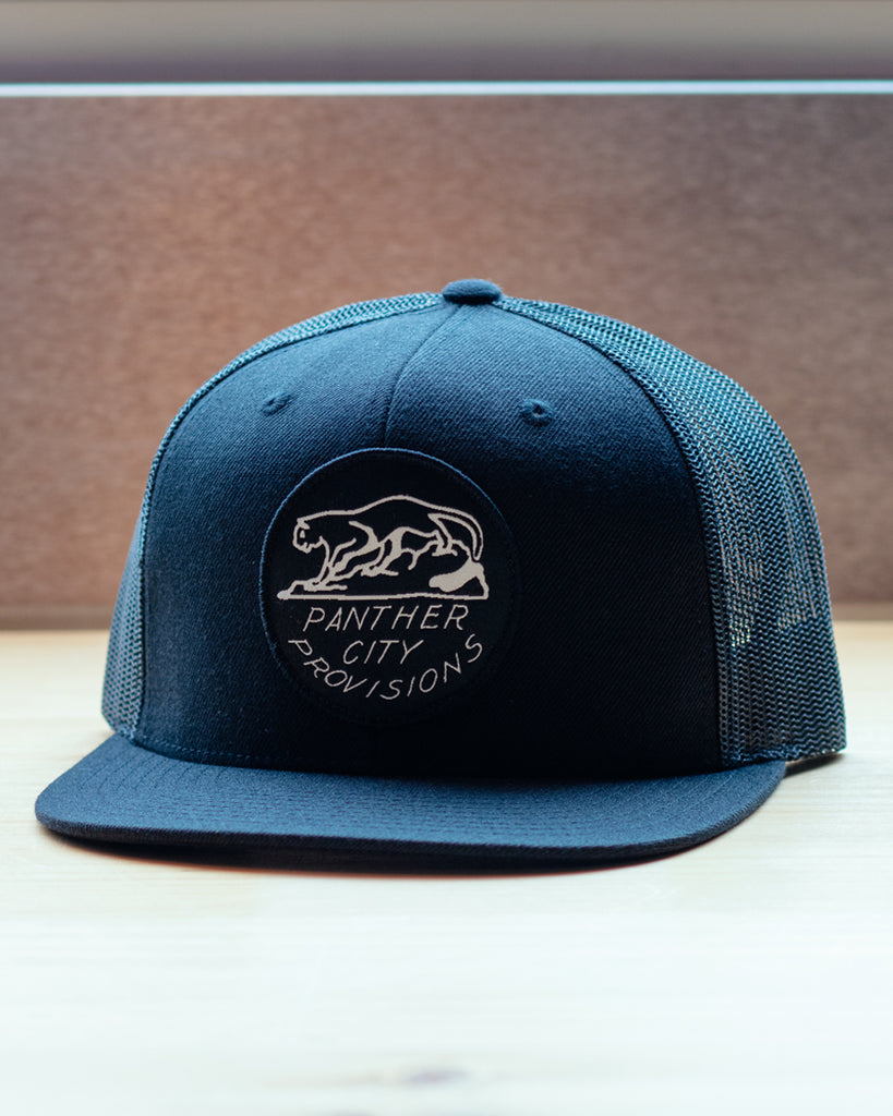 Panther City Provisions Woven Patch Snapback Trucker Hat