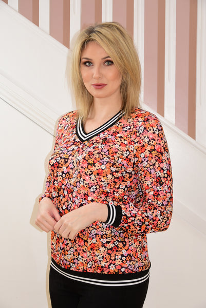 Black V-Neck Top With Orange Floral Design