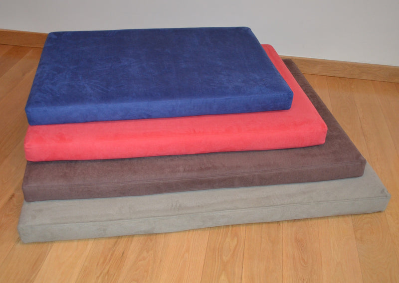 Pile of four different colours and sizes of Signature foam and memory foam dog beds from Big Dog Bed Company