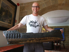 Mikel holding the model ship that endured the fires of the 1st Carlist war in 1837