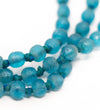 Luminescent African Glass Beads: Turquoise Short Triple Strand