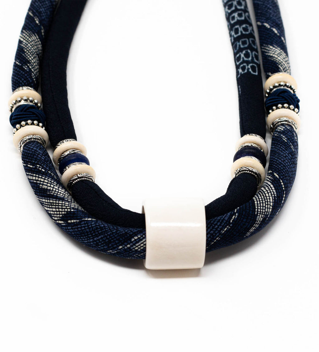 Ox Bone Thumb Ring on Indigo Shibori Cord