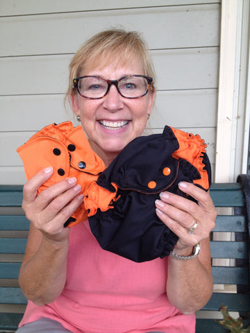 adorable applecheeks halloween diaper thats right boo black outer orange snaps and orange fleece inner and trick or cheeks orange outer