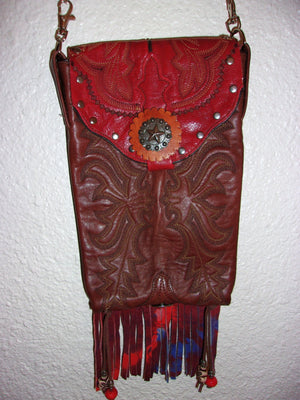 hanging one-of-a-kind red leather crossbody messenger bag handcrafted from cowboy boots