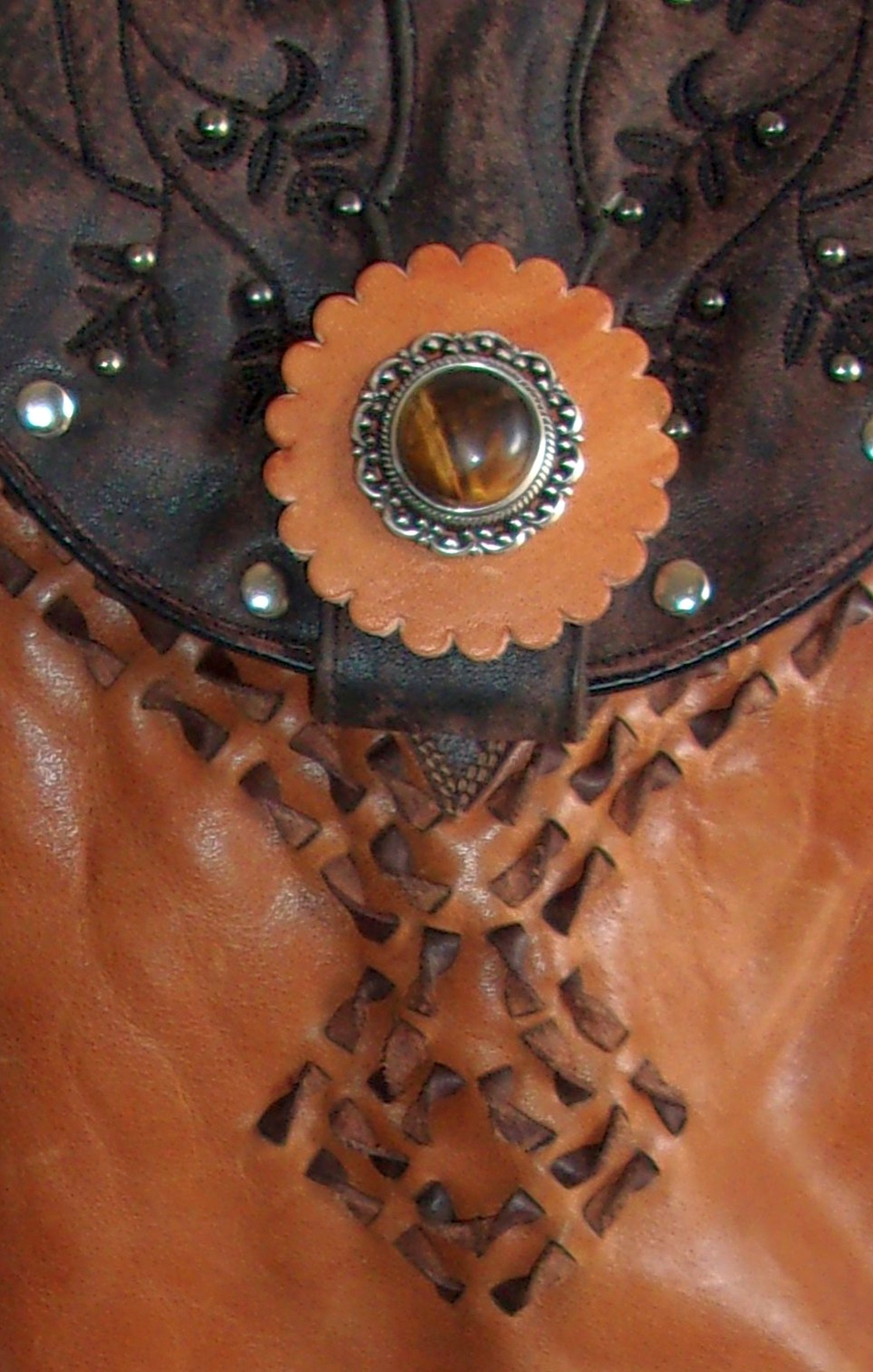 close up tigers eye fringed unique small leather purse crossbody bag handcrafted from recycled cowboy boots