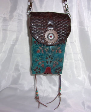 view of turquoise and red flowers handcrafted southwest cross-body small leather bag made from cowboy boots