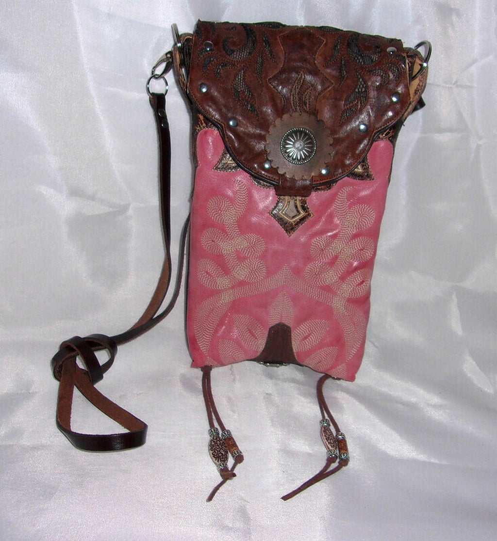 pink handcrafted cross-body small leather bag made from reclaimed recycled cowboy boots