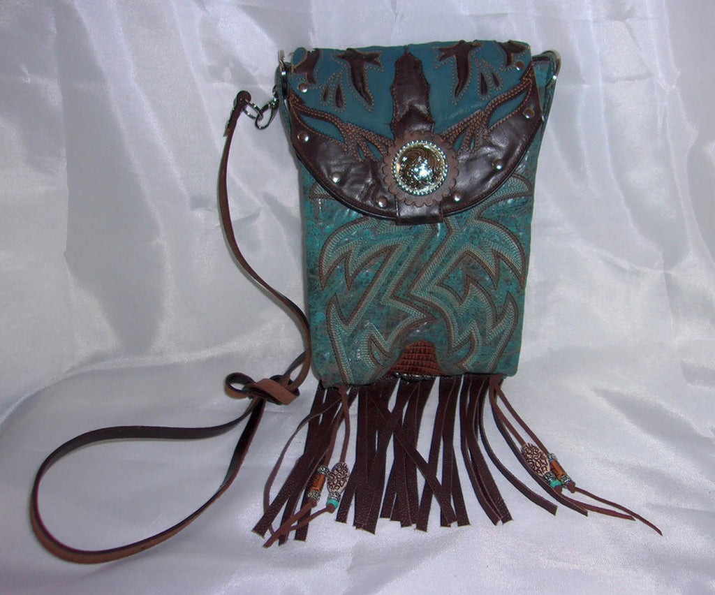 view of small blue leather purse with bluebirds made from reclaimed cowboy boots