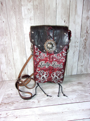 front view of Lady Luck small leather cross-body messenger hipster bag handcrafted from reclaimed recycled cowboy boots