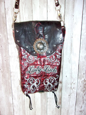 back of Lady Luck small leather cross-body messenger hipster bag handcrafted from reclaimed recycled cowboy boots