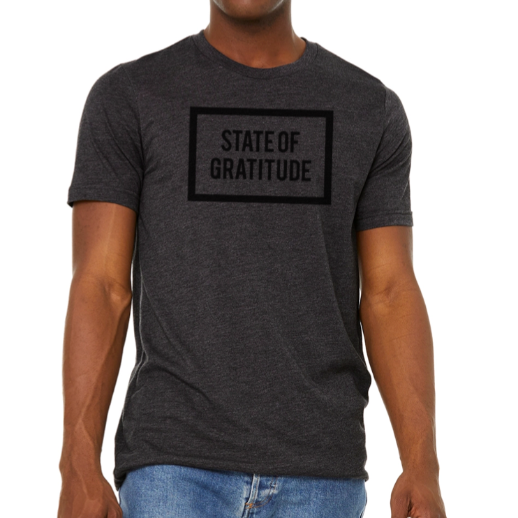 STATE OF GRATITUDE DARK GREY TOP, BLACK LOGO ON FRONT, WELLNESS APPAREL, GRATITUDE APPAREL, ORLANDO SAPIA, BUILD ME UP, HGTV CLOTHING