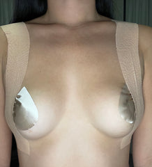 nude boob tape used over shoulder for lift