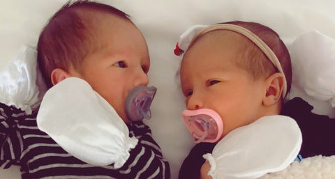 Twin babies looking at each other