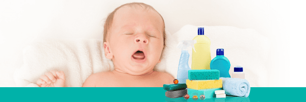 baby with sponges and cleaning products