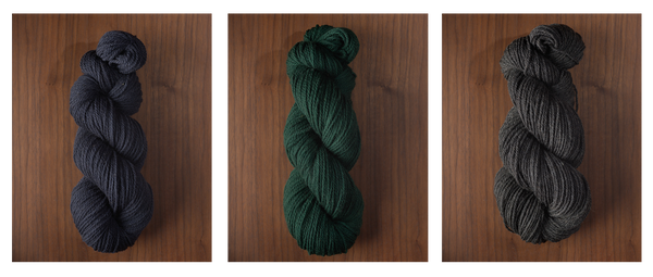 Images of three colors of yarn—navy blue, evergreen, and charcoal