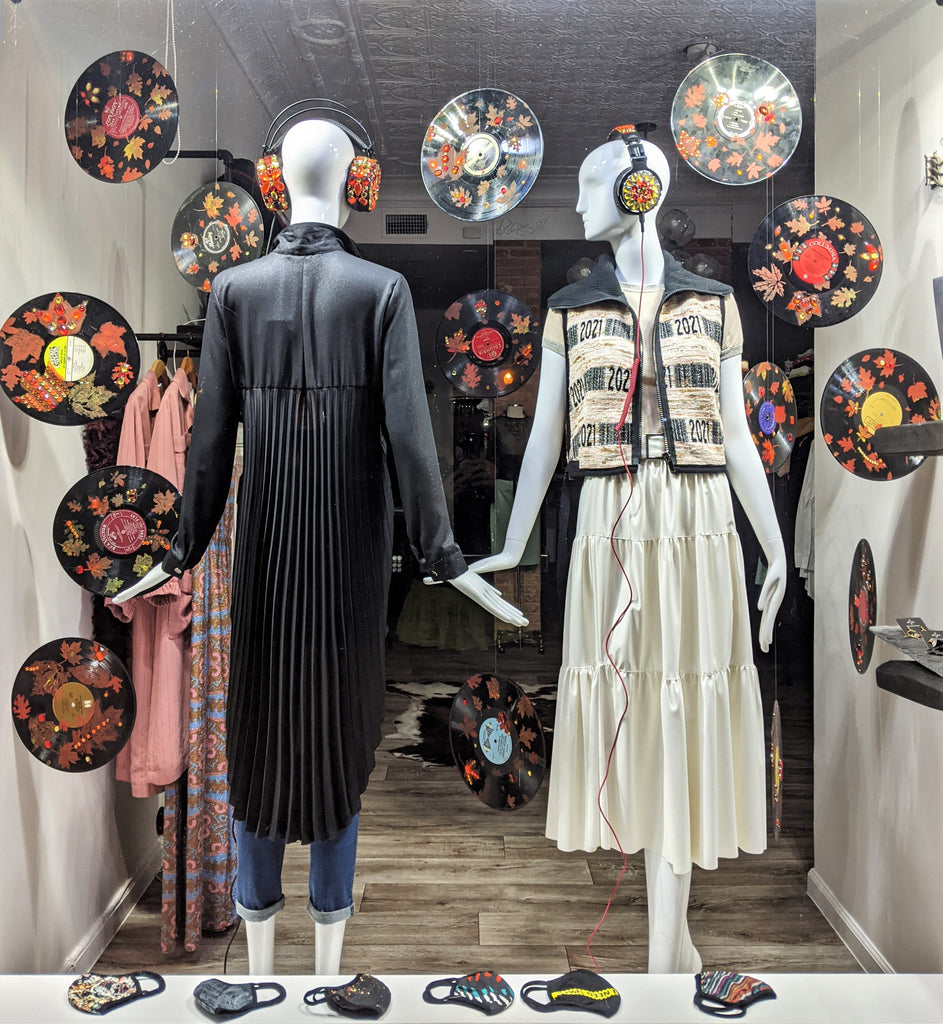 Fall Collection window featuring vintage vinyl records and embellished head sets