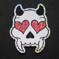 Glitter Heart Eyed Devil Skull Sticker