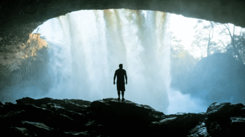 A man getting out of a cave