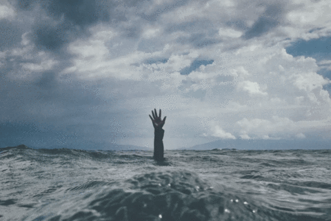 Somebody who is drowning in the ocean