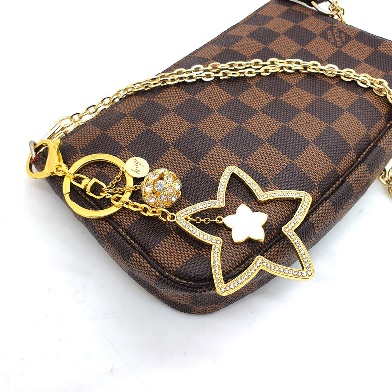 "24k Gold plated ""Melody"" Bag charm"