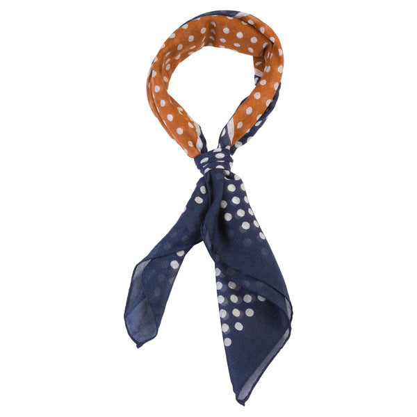 blue and orange male bandana with white dots tied