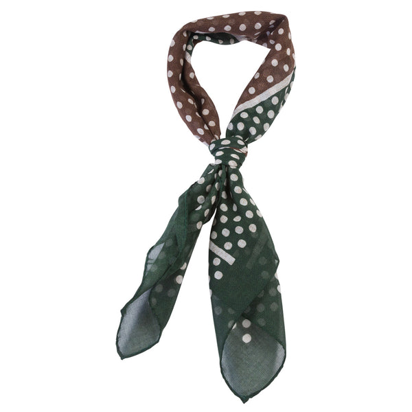 green and brown male bandana with white dots tied