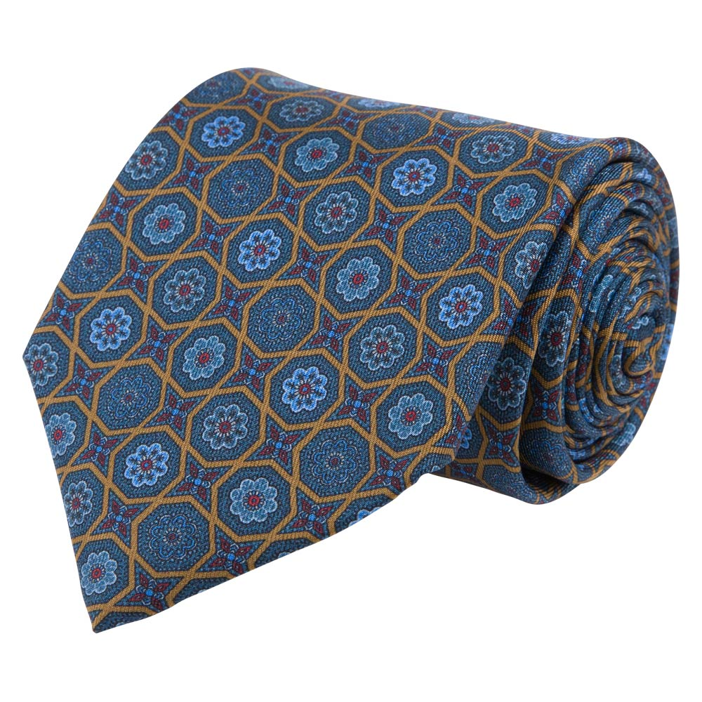 blue and brown patterned silk twill tie rolled