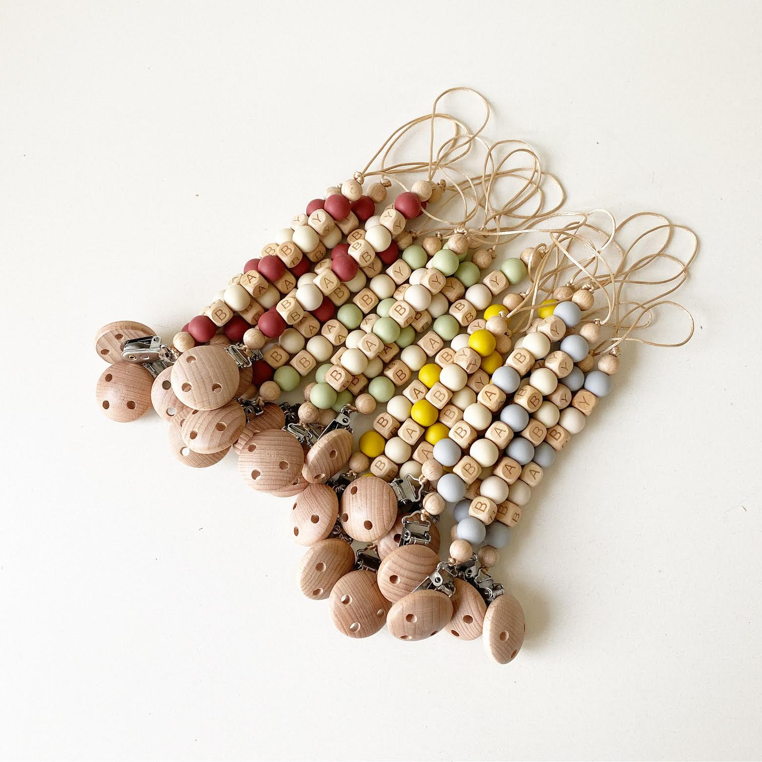 Fussy Teeth:  Silicone + Beech Wood Beads Pacifier Clips - rose, sage, grey, mustard