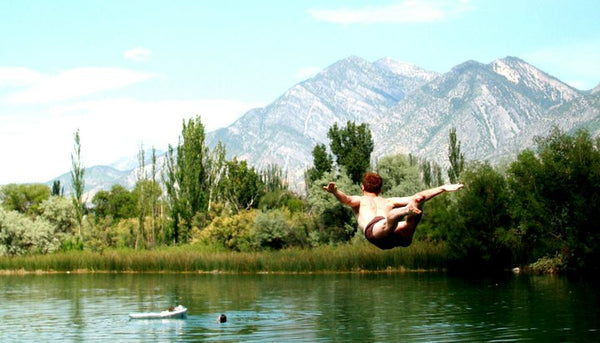 Jumping into the Lake in Brown Swim Short Shorts Photos