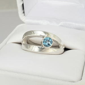 Eye Ring with 5mm round Blue Topas
