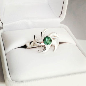 Vortex Ring with Green Peridot Stone