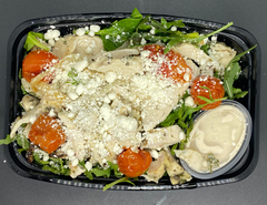 Baby Arugula and Baby Spinach mixed with Oil-Roasted Cherry Tomatoes, Crumbled Goat Cheese, Red Onion and Herb-Grilled Chicken Breast with a Creamy Lemon-Balsamic Dressing