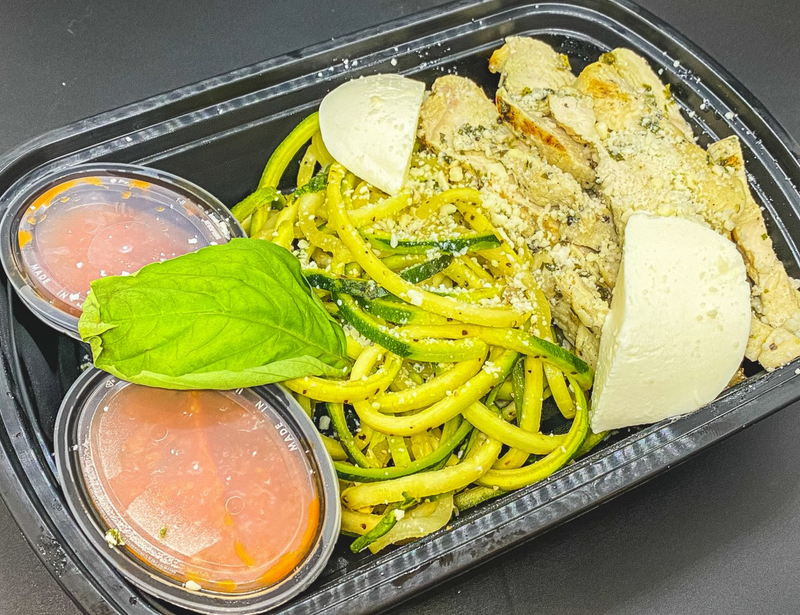 Herb Roasted Chicken Breast Served over Fresh Zucchini Noodles with House-Made Marinara and Fresh Mozzarella. Garnished with Grated Parmesan and Fresh Herbs