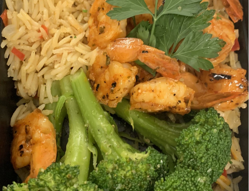 Peri Peri Spiced Shrimp, Roasted with a Zesty Orange Glaze. Served with Citrus Scented Broccoli and Red Pepper Confetti Basmati Rice.