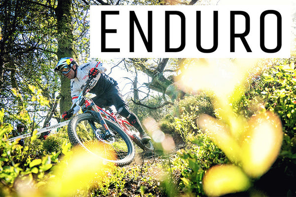 A rider navigating a right hand corner on a long travel enduro style mountain bike