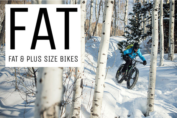 A rider navigating his way down through a section of snow on a fat bike style of mountain bike