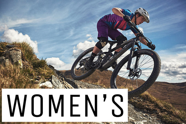 A girl on a women's specific mountain bike riding down a rocky trail