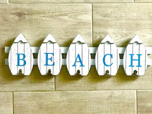 "White ""Beach"" Sign made with little White Surfboards and With Clips on the Bottom"