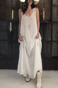 A Sleeveless, Loose Floor Length Dress In A Fashionable Solid Color