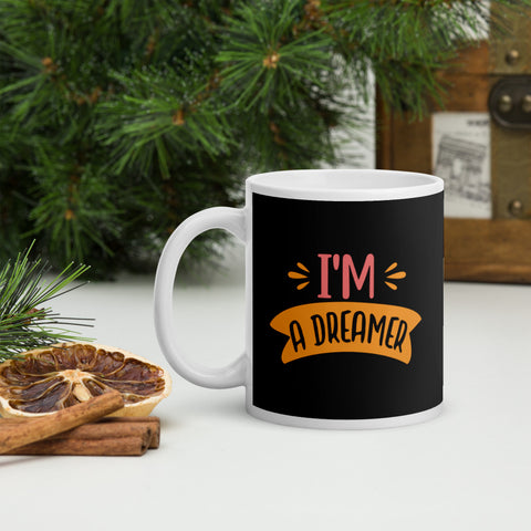 I'm A Dreamer Adventure Coffee Mug Whether you're drinking your morning coffee, evening tea, or something in between – this mug's for you! It's sturdy and glossy with a vivid print that'll withstand the microwave and dishwasher.