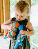 PEBBLE BLUE DIPPI DINOSAUR RATTLE