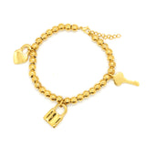 ESBL 6576: 30-Bead Gold-Plated Tiffany Bracelet w/ Key Lock & Heart Charm