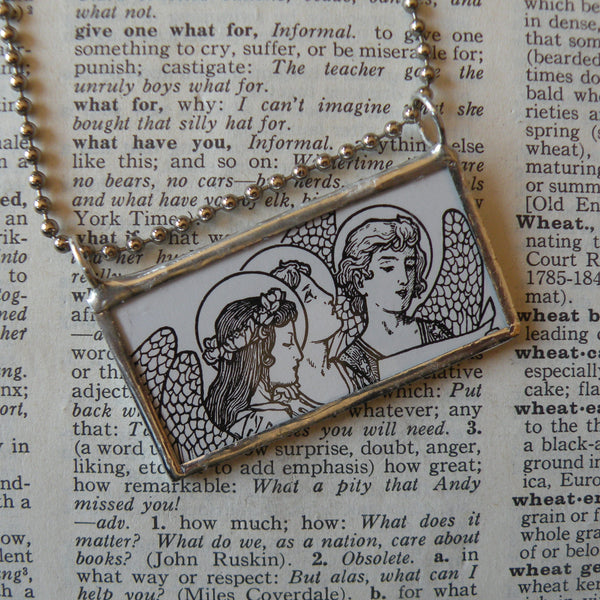 Angel and sun, Medieval style illustrations, up-cycled to hand soldered glass pendant