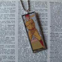 Vintage baseball player, vintage illustration from fireworks packaging, soldered glass pendant