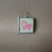 Pink bichon frise, green schnauzer, Japanese kawaii illustrations up-cycled to hand-soldered glass pendant