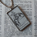 Cowboy and bucking bronco horse, vintage dictionary illustration, hand-soldered glass pendant