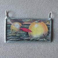 Retro rocket and space city, vintage comic book illustration, upcycled to soldered glass pendant
